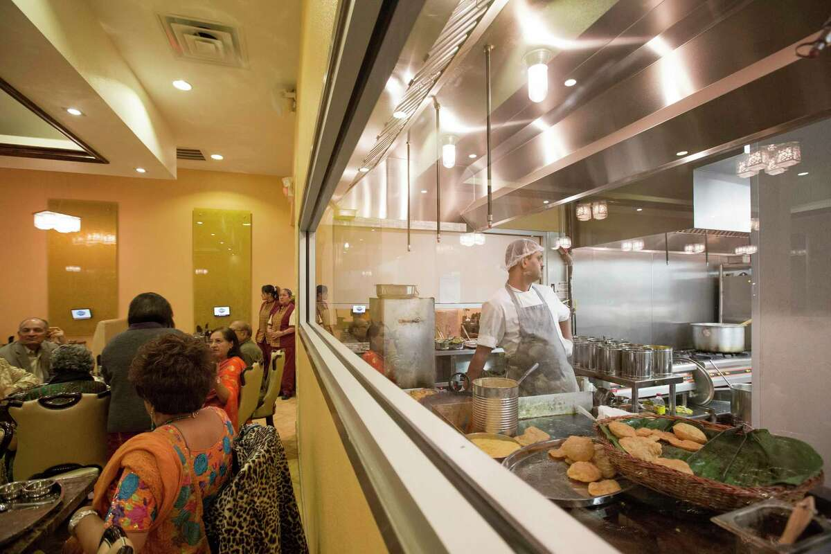 Maharaja Bhog restaurant in Houston, photographed Nov. 16, 2012, has a large window between the kitchen and dining room. The executive chef at the restaurant has been denied a visa, based on the contention that his job doesn't require specialized knowledge.