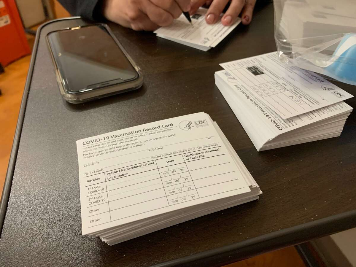 After receiving the coronavirus vaccine at Northeast Baptist Hospital, a staff person fills out a card with the date of the first dose and from which site, as well as the batch number, and gives the card to the patient to help keep track. The patient is required to return in three or four weeks, depending on what kind of vaccine they received.