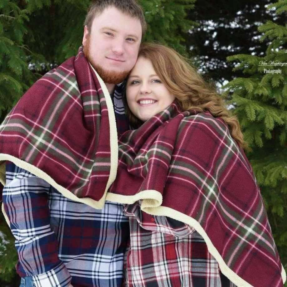 Madison Finkel, pictured here with her husband Corey, is one of the many healthcare professionals still facing changes made to their work environment since the beginning of the pandemic. (Courtesy Photo)