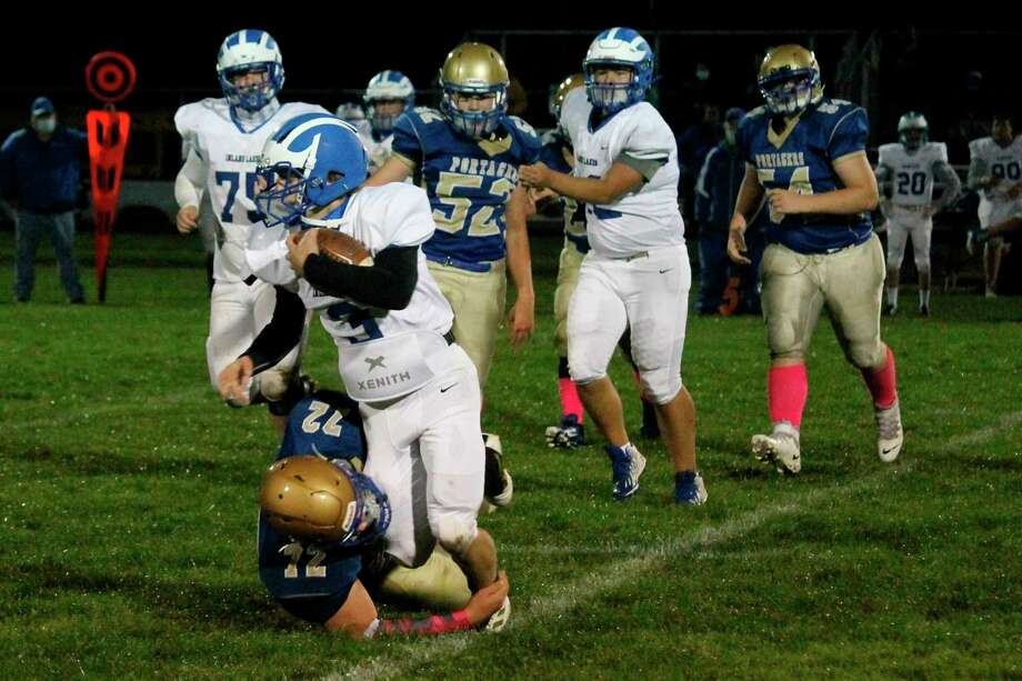 Ben Falk tackles an Inland Lakes ball carrier before he can turn the corner during a game on Oct. 2. (News Advocate file photo)