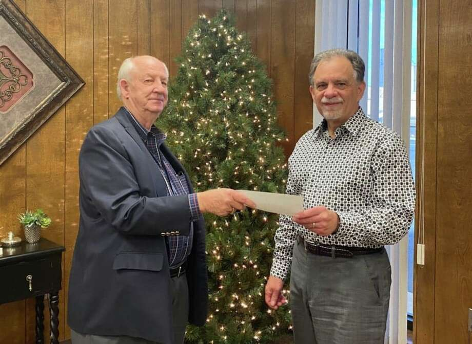 David Wilder (left), with the James and Eva Mayer Foundation, hands Ron Hanby, (right) with FISH, a $5,000 check. Photo: Provided By The James And Eva Mayer Foundation