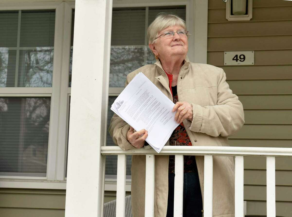 Regina Dew holds her new lease as she stands outside of her home on Wednesday, Jan. 6, 2021 in Albany, N.Y. (Lori Van Buren/Times Union)