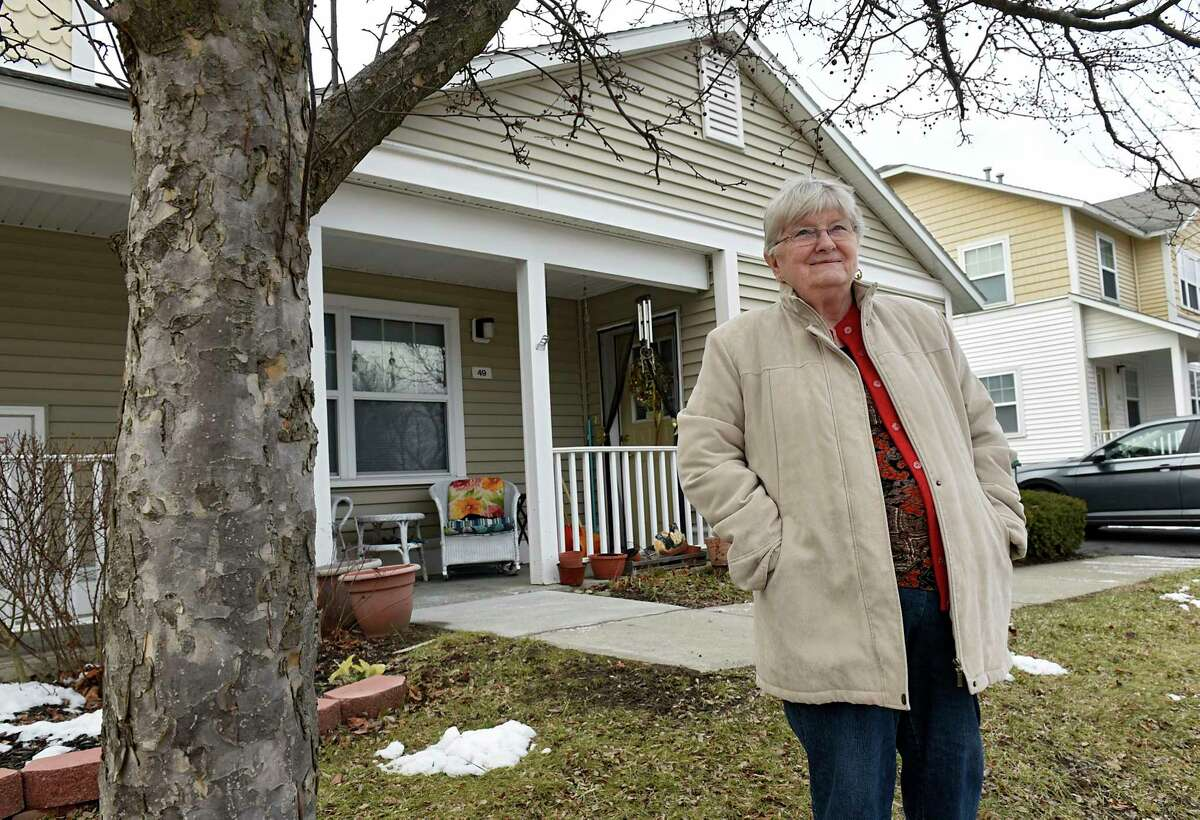 Regina Dew stands outside of her home on Wednesday, Jan. 6, 2021 in Albany, N.Y. (Lori Van Buren/Times Union)