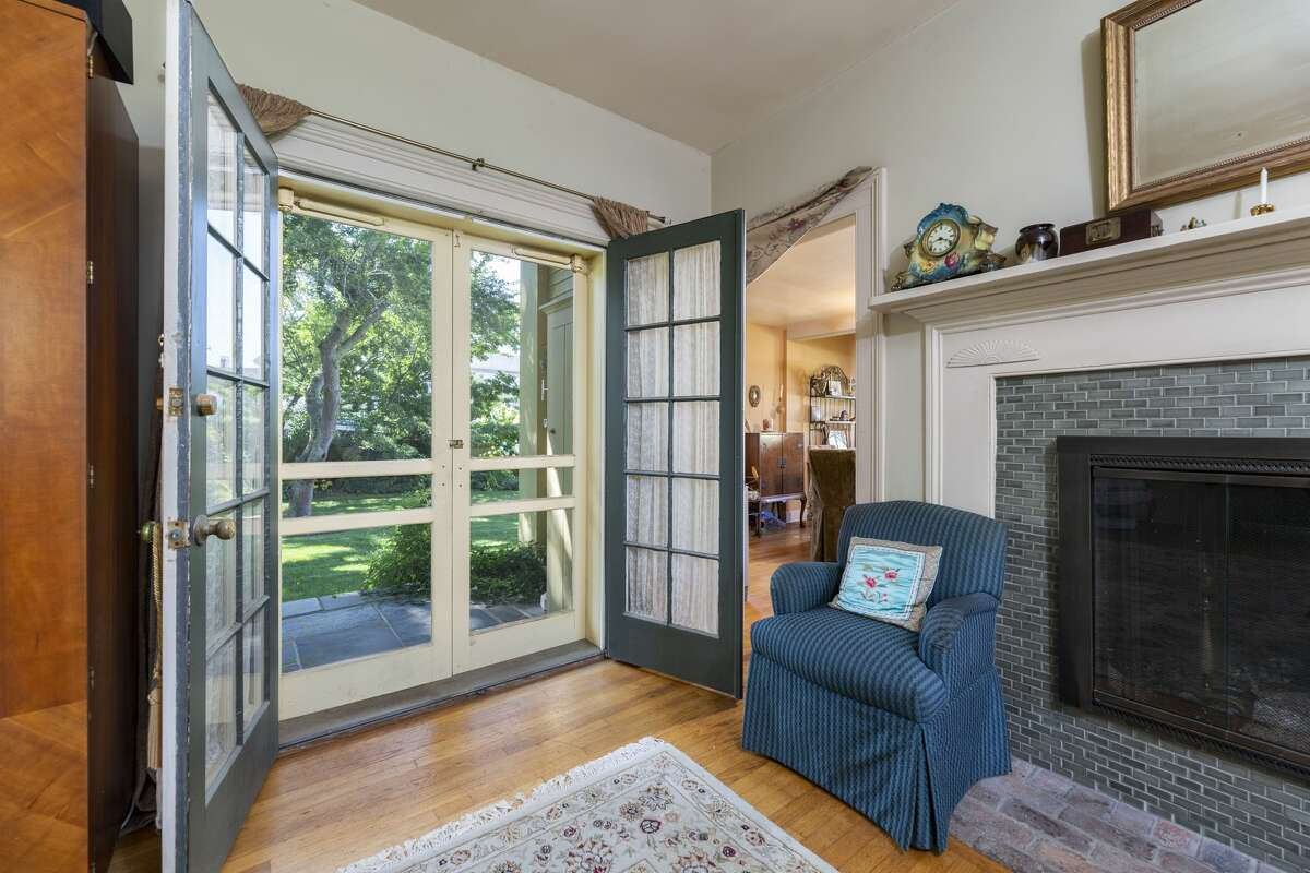 Living room at 176 Water Street, Unit 3, Stonington with French doors to a covered porch and attractive grounds. Cameron described Unit 3, which is on the market, as an