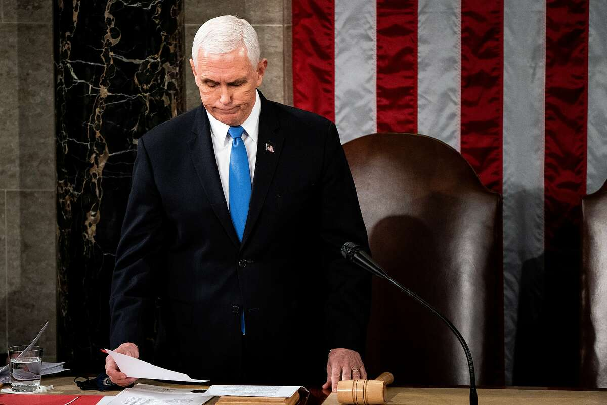 Vice President Mike Pence presides over a joint session of Congress on Wednesday convened to certify the Electoral College votes cast in the November election. A chorus of politicians is calling on Pence to invoke the 25th Amendment to remove President Trump from office.
