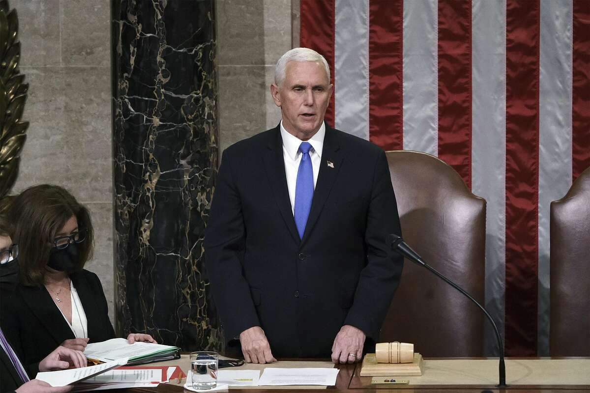 WASHINGTON, DC - JANUARY 07: Vice President Mike Pence reads the final certification of Electoral College votes cast in November's presidential election during a joint session of Congress, after working through the night, at the Capitol on January 7, 2021 in Washington, DC. Congress reconvened to ratify President-elect Joe Biden's 306-232 Electoral College win over President Donald Trump, after a pro-Trump mob broke into the U.S. Capitol and disrupted proceedings. (Photo by J. Scott Applewhite - Pool/Getty Images)