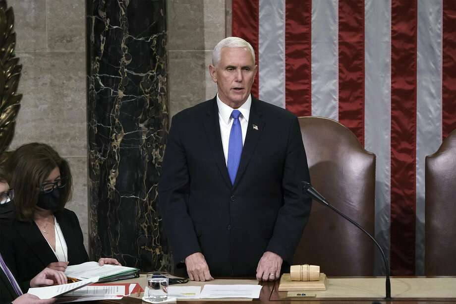 WASHINGTON, DC - JANUARY 07: Vice President Mike Pence reads the final certification of Electoral College votes cast in November's presidential election during a joint session of Congress, after working through the night, at the Capitol on January 7, 2021 in Washington, DC. Congress reconvened to ratify President-elect Joe Biden's 306-232 Electoral College win over President Donald Trump, after a pro-Trump mob broke into the U.S. Capitol and disrupted proceedings. (Photo by J. Scott Applewhite - Pool/Getty Images) Photo: Pool, Getty Images