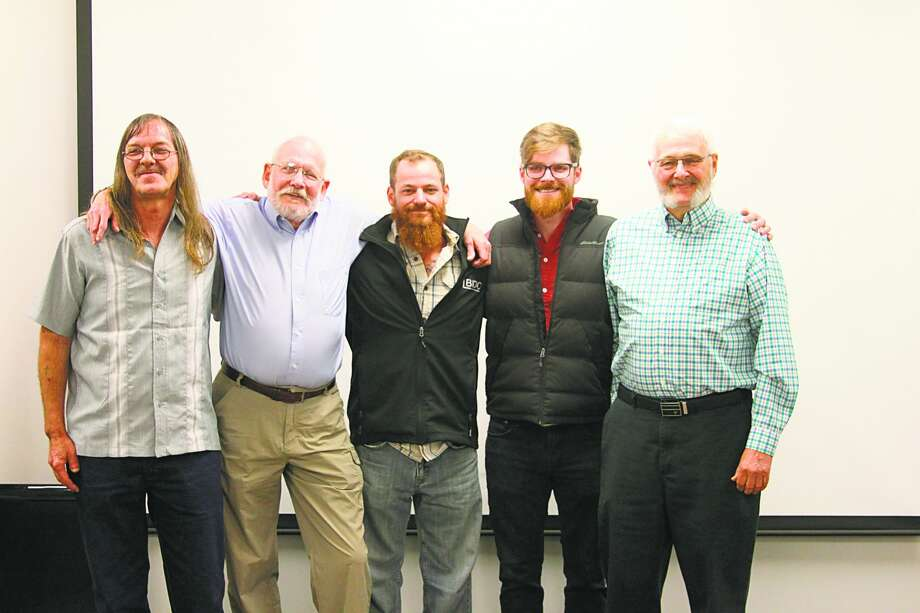 Frankfort resident Kim Fairchild was rescued from a near drowning on the Big Manistee River on June 6, 2019 when fishing with his friend Rick Herman (far right). The three who pulled the non-breathing Fairchild from the water and revived him were Troy Ance, Ben Blostein and Steven Padilla. The three were honored by then-Manistee County Sheriff John O'Hagan for their heroic act. Pictured (from left to right) are Ance, Fairchild, Blostein, Padilla and Herman. (File photo) Photo: File Photo