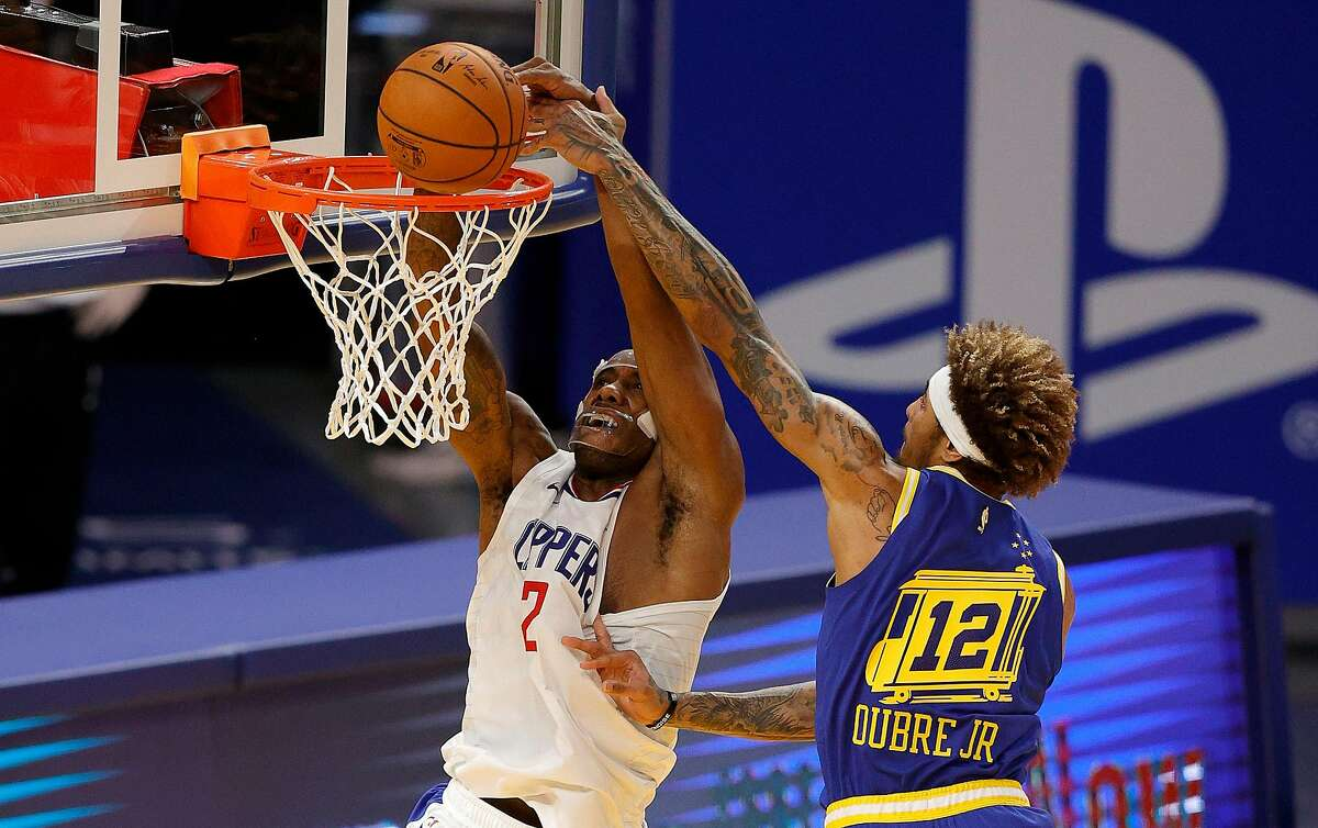 Kawhi Leonard (2) and the Clippers beat Kelly Oubre Jr. and the Warriors 108-101 on Wednesday night. The teams meet again at Chase Center at 7 p.m. Friday (NBCSBA, ESPN/95.7).