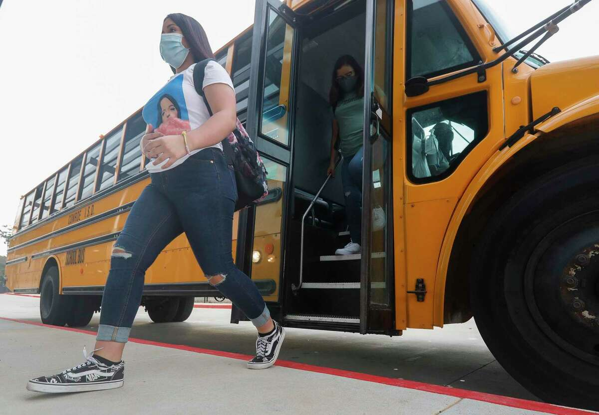 Students get of buses wearing face masks at Stockton Junior High School on the first day of in-person school for Conroe ISD on Sept. 8 in Conroe. Conroe ISD students are set to return to class on Aug. 11. But as students return, the strict COVID-19 mandates of last year will not, and the district won't be able to mandate that students positive with COVID-19 stay home to isolate.