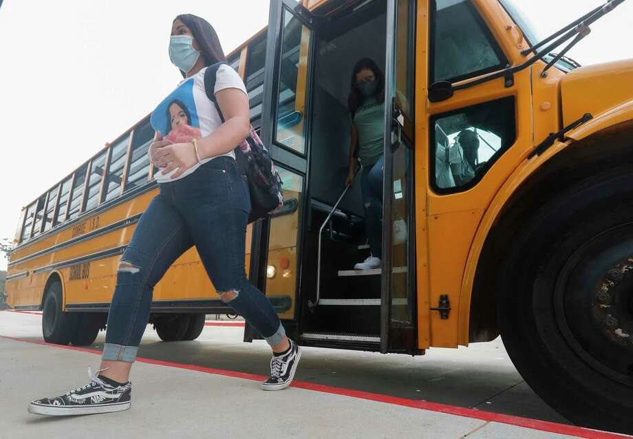 Students get of buses wearing face masks at Stockton Junior High School on the first day of in-person school for Conroe ISD in September. Of the nearly 65,000 students in the Conroe Independent School District, 52,060 chose to return to in-class instruction for the second half of what has been an unexpected and ever-changing school year. All students returned to school Wednesday for the second semester, 12,703 of them in online instruction. Photo: Jason Fochtman, Houston Chronicle / Staff Photographer / 2020 © Houston Chronicle
