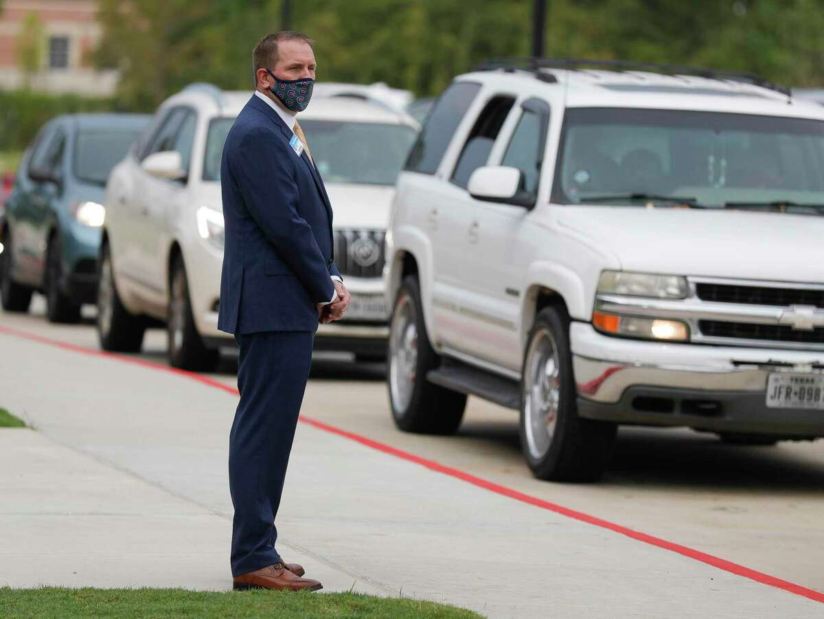 Conroe ISD Superintendent Curtis Null watches students arrive at Stockton Junior High School on the first day of in-person school for Conroe ISD, Tuesday, Sept. 8, 2020, in Conroe.