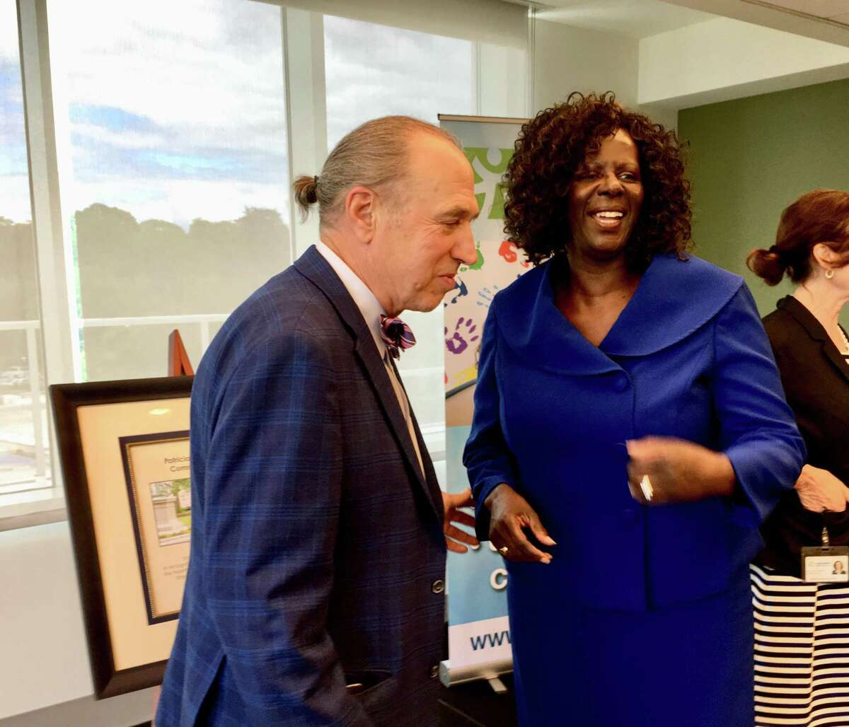 Rep. Patricia Billie Miller, D-Stamford, talks with Mark Masselli, CEO of Community Health Center Inc., after the group dedicated a community room at its new Stamford clinic in Miller's honor.