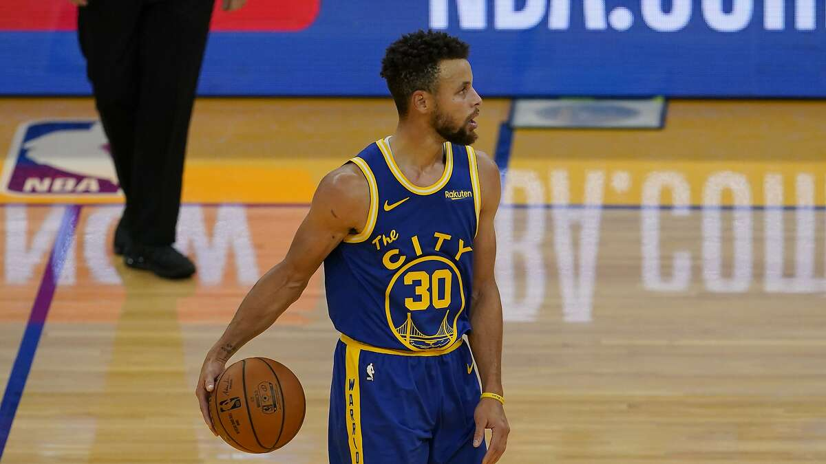 Golden State Warriors guard Stephen Curry (30) against the Los Angeles Clippers during an NBA basketball game in San Francisco, Wednesday, Jan. 6, 2021. (AP Photo/Jeff Chiu)