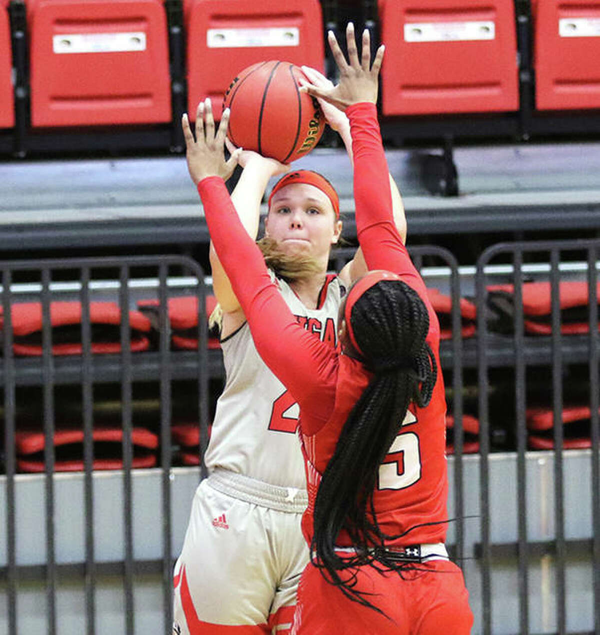 SIUE's Madison Hackstadt shoots a 3-pointer over Myah LeFlore on Thursday afternoon at First Community Arena in Edwardsville.