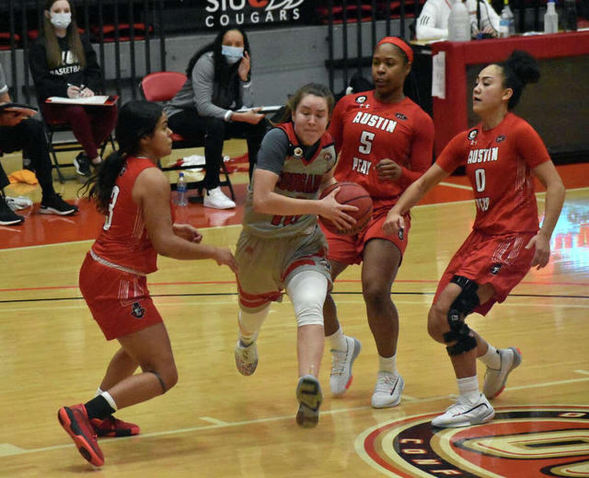 SIUE guard Sara Majorosova slashes through three Austin Peay defenders on her way to the basket in the third quarter of Thursday's Ohio Valley Conference game.