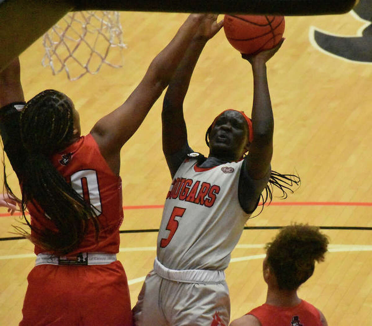 SIUE forward Ajulu Thatha goes up for a contested shot in the lane in the second quarter.
