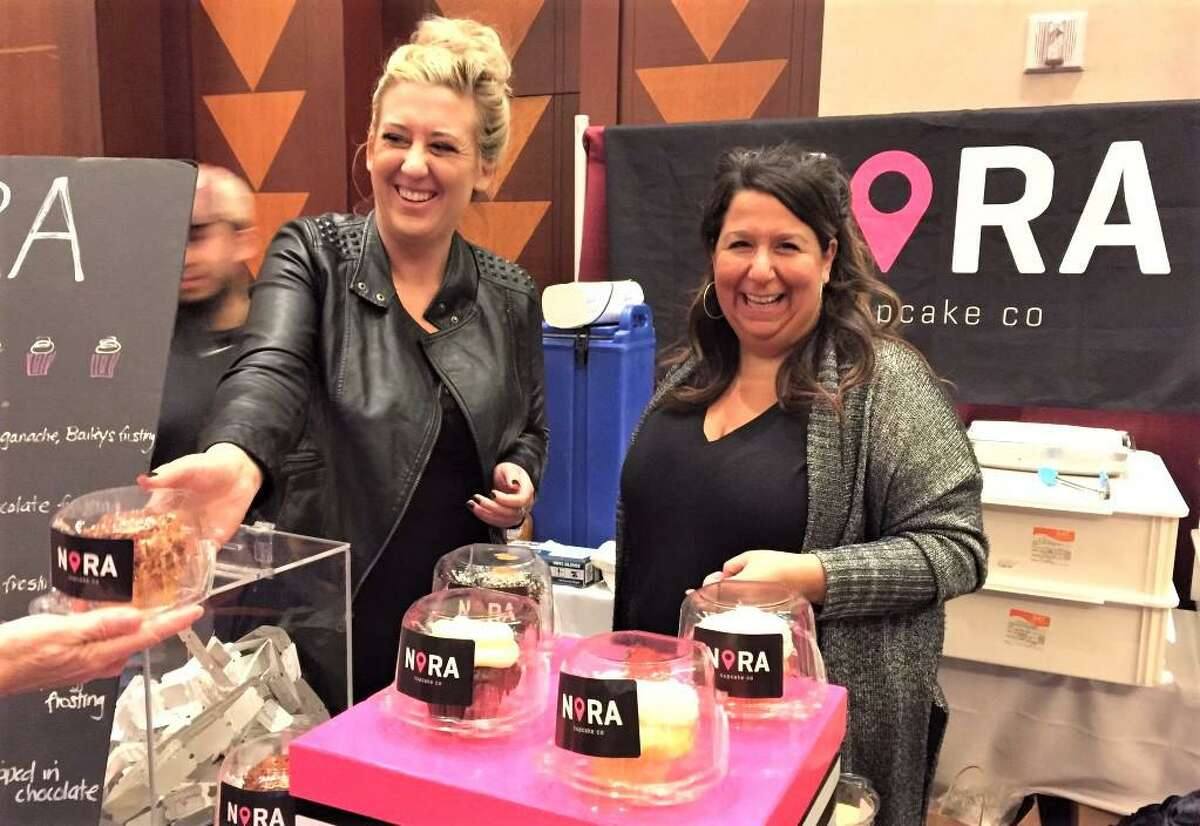 NoRA Cupcake Co. owner Carrie Carella, right, and operations manager Heather Kelly, left, have launched a new eatery soon to occupy the old Pameacha Jail at 51 Warwick St. in Middletown. The casual dining spot will focus on sandwiches with a twist, comfort food and craft cocktails.