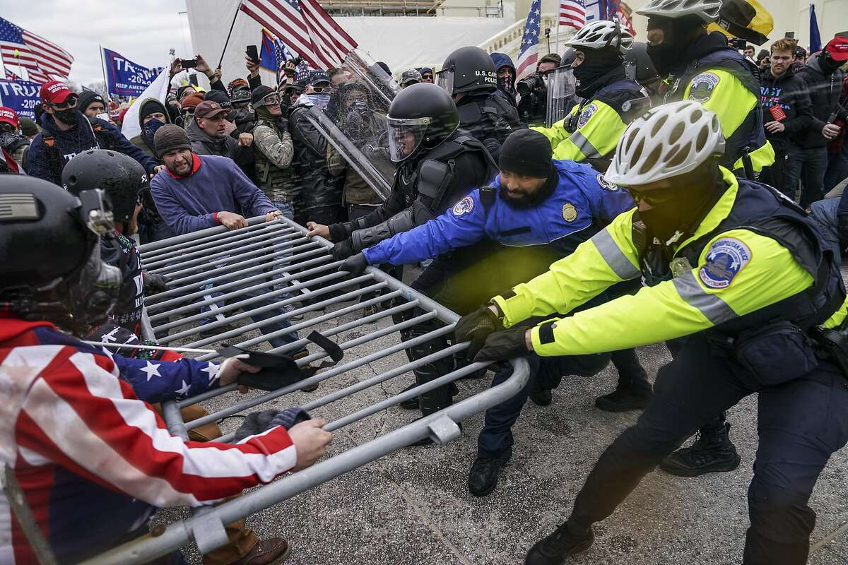 Trump supporters try to break through a police barrier on Jan. 6 at the Capitol in Washington, D.C.