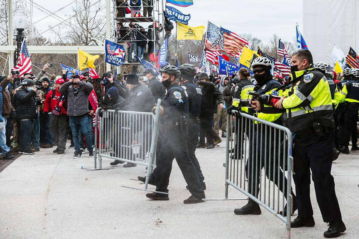 FILE: A large group of pro-Trump rioters face off against police with pepper spray after they stormed the grounds of the Capitol Building on January 6.
