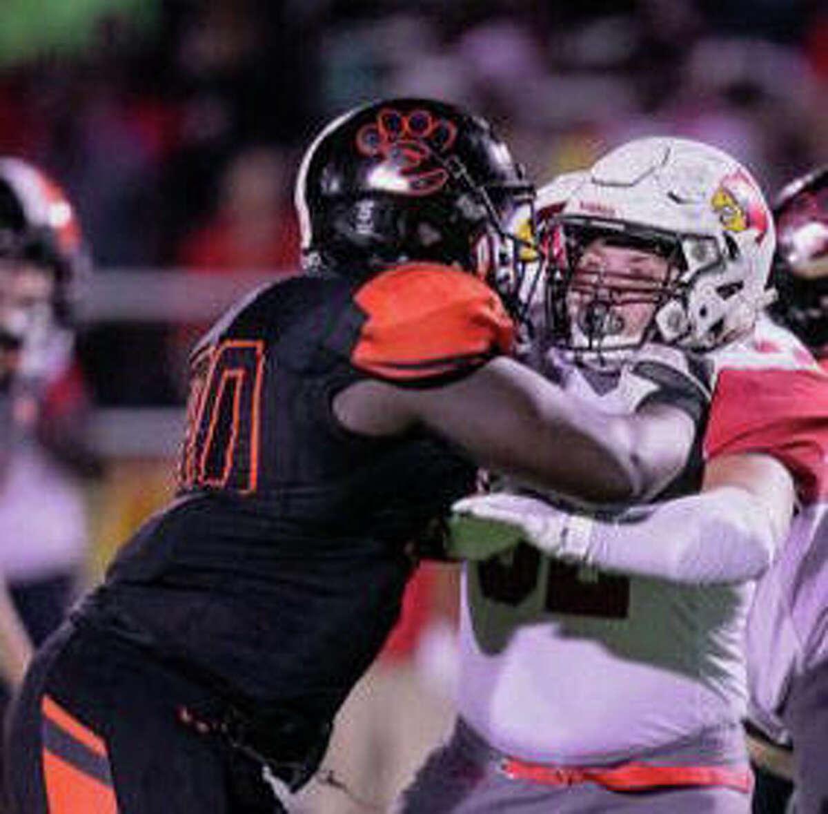 Edwardsville junior Nasim Cairo, left, in action against Alton during his sophomore season.