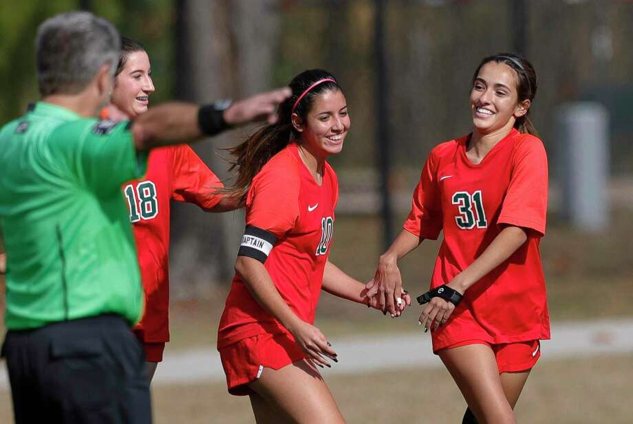 The WoodlandsBella Dillow (31) reacts with Kendall Repa (18) after scoring a goal in the second period of a match during the Lady Highlander Invitational at Gosling Sports Field, Thursday, Jan. 7, 2021, in The Woodlands. Photo: Jason Fochtman, Houston Chronicle / Staff Photographer / 2021 © Houston Chronicle
