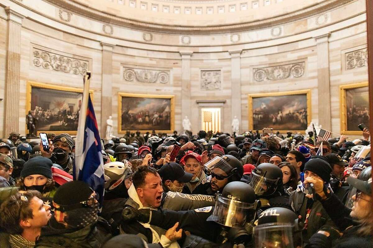 Police intervenes in US President Donald Trumps supporters who breached security and entered the Capitol building in Washington D.C., United States on January 06, 2021.