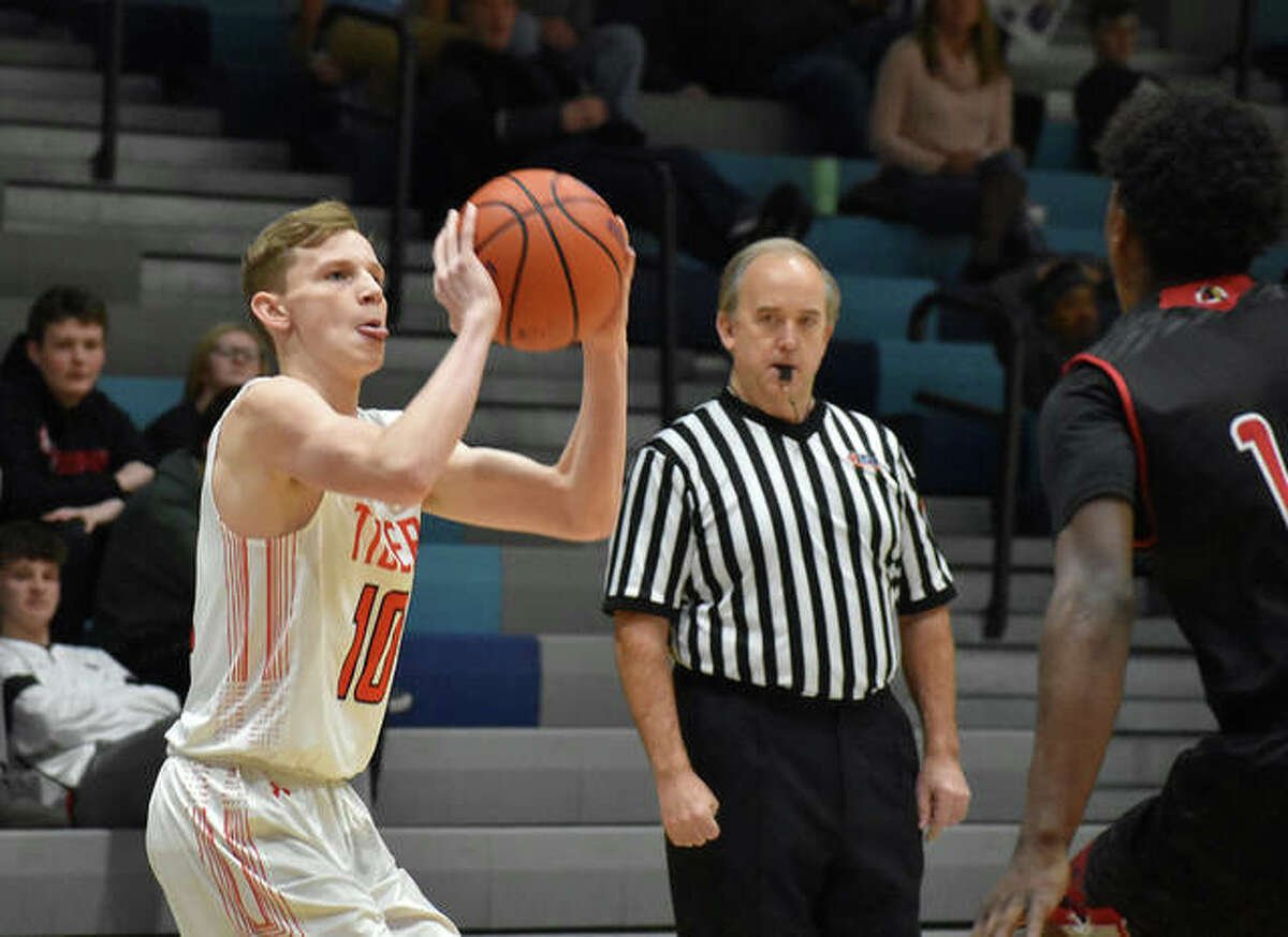 Edwardsville guard Preston Weaver eyes a 3-point attempt during a game last season against Granite City in Jerseyville.