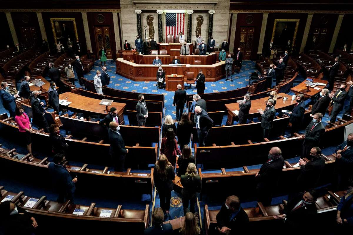 Electoral College votes are returned to a joint session of Congress hours after a mob supporting President Donald Trump broke into the Capitol and disrupted the proceedings, in Washington on Wednesday, Jan. 6, 2021. Some scientists fear that the mayhem on Capitol Hill may have been a so-called super-spreading event. (Erin Schaff/The New York Times)
