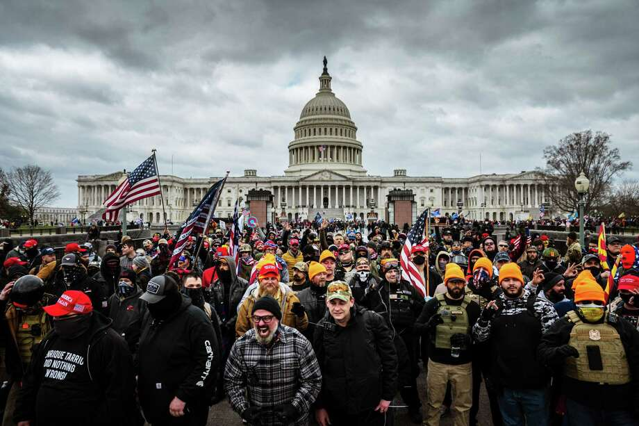 Rioters stormed the U.S. Capitol on Jan. 6, which resulted in five deaths including a Capitol police officer. Photo: Jon Cherry/Getty Images, MBR / TNS / Chicago Tribune