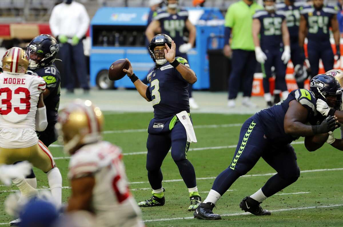 GLENDALE, ARIZONA - JANUARY 03: Quarterback Russell Wilson #3 of the Seattle Seahawks throws a pass during the first half against the San Francisco 49ers at State Farm Stadium on January 03, 2021 in Glendale, Arizona. (Photo by Chris Coduto/Getty Images)
