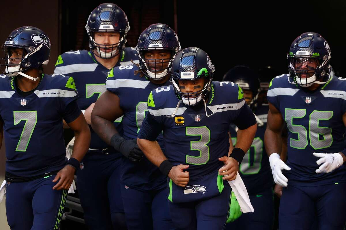 GLENDALE, ARIZONA - JANUARY 03: Quarterback Russell Wilson #3 of the Seattle Seahawks leads teammates onto the field before the NFL game against the San Francisco 49ers t State Farm Stadium on January 03, 2021 in Glendale, Arizona. The Seahawks defeated the 49ers 26-23. (Photo by Christian Petersen/Getty Images)