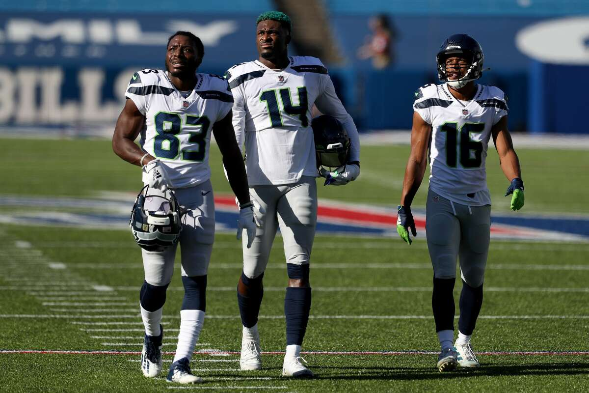ORCHARD PARK, NEW YORK - NOVEMBER 08: David Moore #83, DK Metcalf #14, and Tyler Lockett #16 of the Seattle Seahawks walk off the field after warming up before a game against the Buffalo Bills at Bills Stadium on November 08, 2020 in Orchard Park, New York. (Photo by Bryan Bennett/Getty Images)