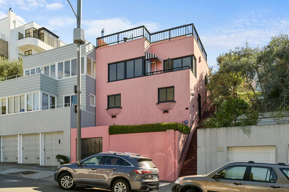 The pink abode has tons of curb appeal, standing out from its neighbors on Telegraph Hill.