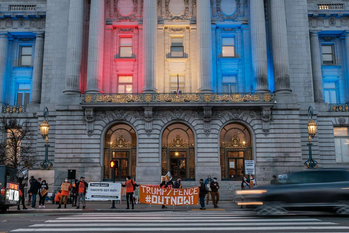 People gather at City Hall for a 'Refuse Fascism' protest in San Francisco on Thursday, January 7, 2021. A small but vocal group of people demanding Trump leave office now descended on City Hall before marching to the Twitter building.