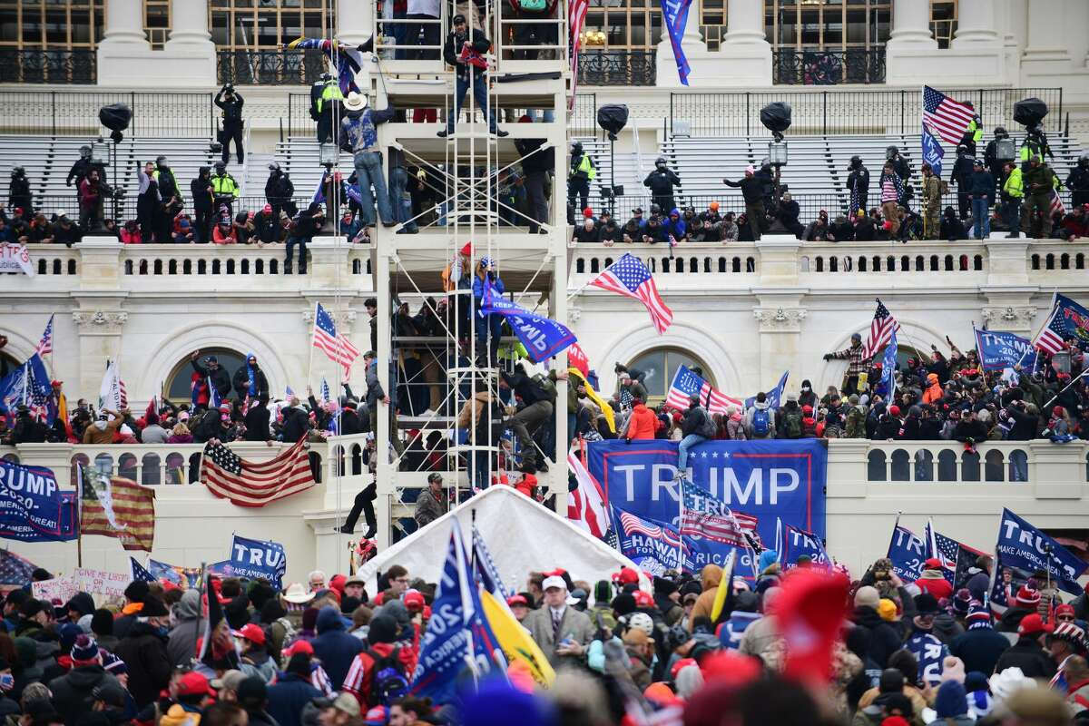 Supporters of President Donald Trump riot at the U.S. Capitol on Jan. 6, 2021. MUST CREDIT: Photo for The Washington Post by Astrid Riecken