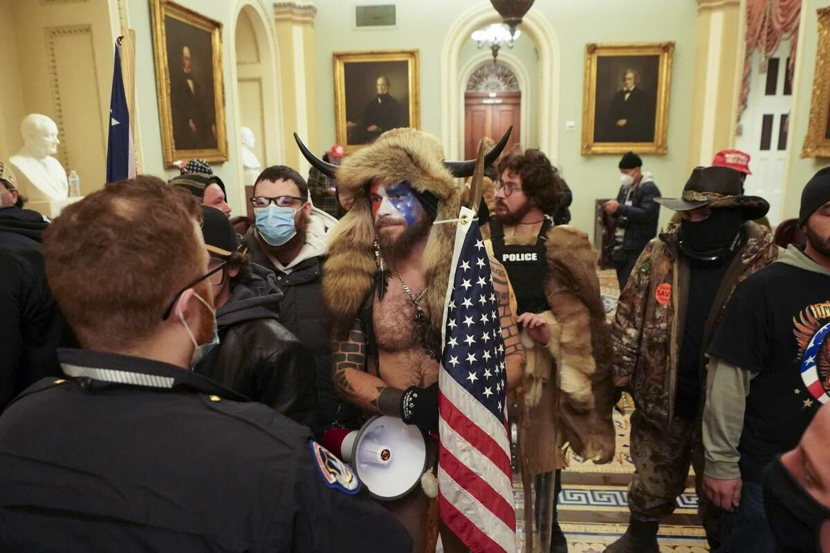 Supporters of President Donald Trump who swarmed the U.S. Capitol confront Capitol Police officers in the building, in Washington, Jan. 6, 2021. As people rushed inside, there was a strange mix of confusion and excitement, and the almost complete lack of police presence in the beginning amplified the feeling of lawlessness. (Erin Schaff/The New York Times)