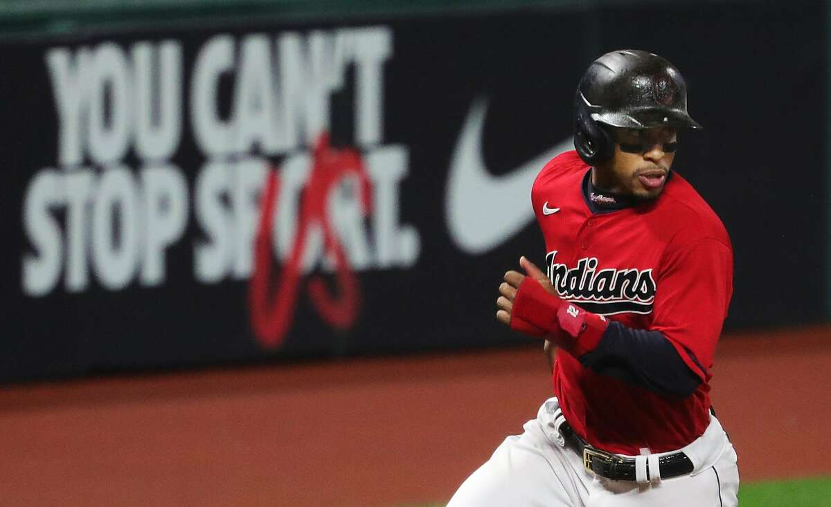 Cleveland Indians shortstop Francisco Lindor (12) rounds third on his way to home plate during the fifth inning of Game 2 of the American League Wild Card Series, Wednesday, Sept. 30, 2020, in Cleveland, Ohio. [Jeff Lange/Beacon Journal]