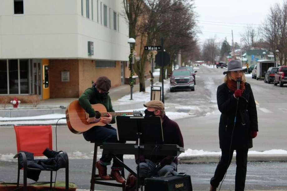 Residents of Riverside Place recently enjoyed an outdoor concert. The residents bundled up in coats and brought their blankets out to hear some live music played by grandchildren of resident Pay Lyle. Pay's grandkids Emily and Thad are very talented and have performed at MCFTA. They were joined by their friend Ryan on guitar. It brought tears to resident's eyes and was good medicine after such a challenging year. (Photos Provided)