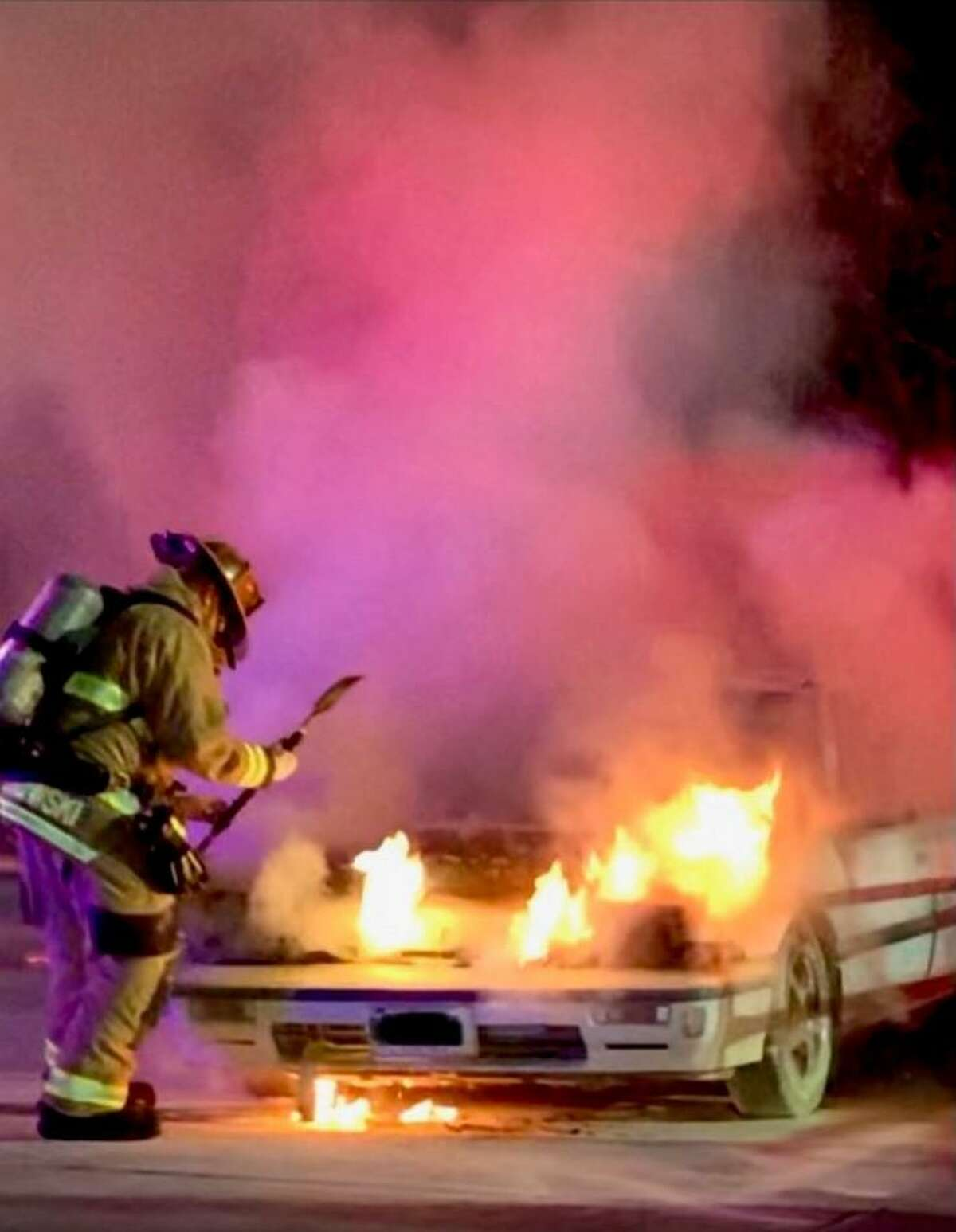 Shelton firefighters battle a car fire in the Walmart parking lot on Thursday, Dec. 7.