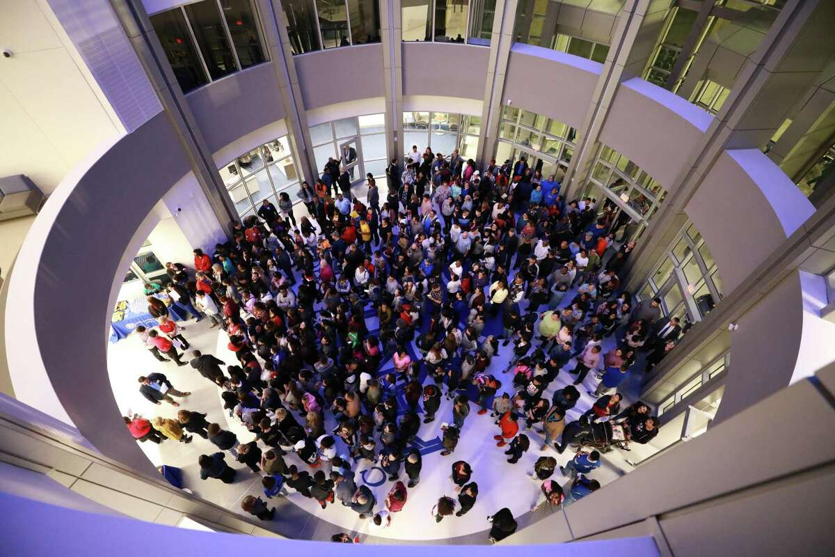 A crowd gathers in the rotunda of C.E. King High School at the ribbon cutting ceremony on Jan. 6, 2020. Two workers on the project say they were victims of wage theft, claiming they were not paid the prevailing wage. Sheldon ISD and the subcontractor deny they were underpaid.