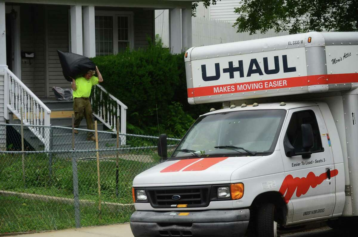A tenant's belongings are removed from a home in Norwalk during an eviction.
