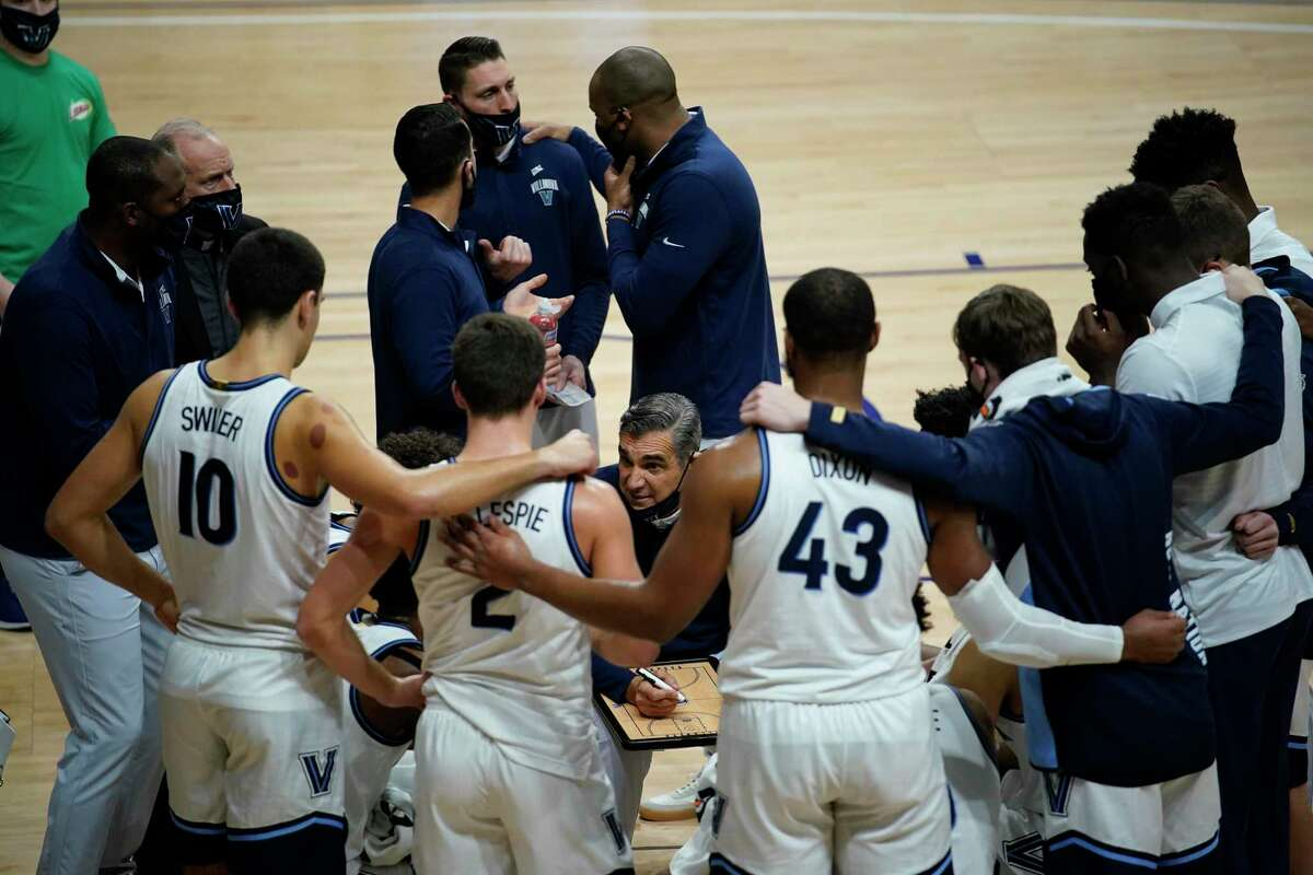 Villanova's Jay Wright coaches during an NCAA college basketball game against Butler, Wednesday, Dec. 16, 2020, in Villanova, Pa. (AP Photo/Matt Slocum)