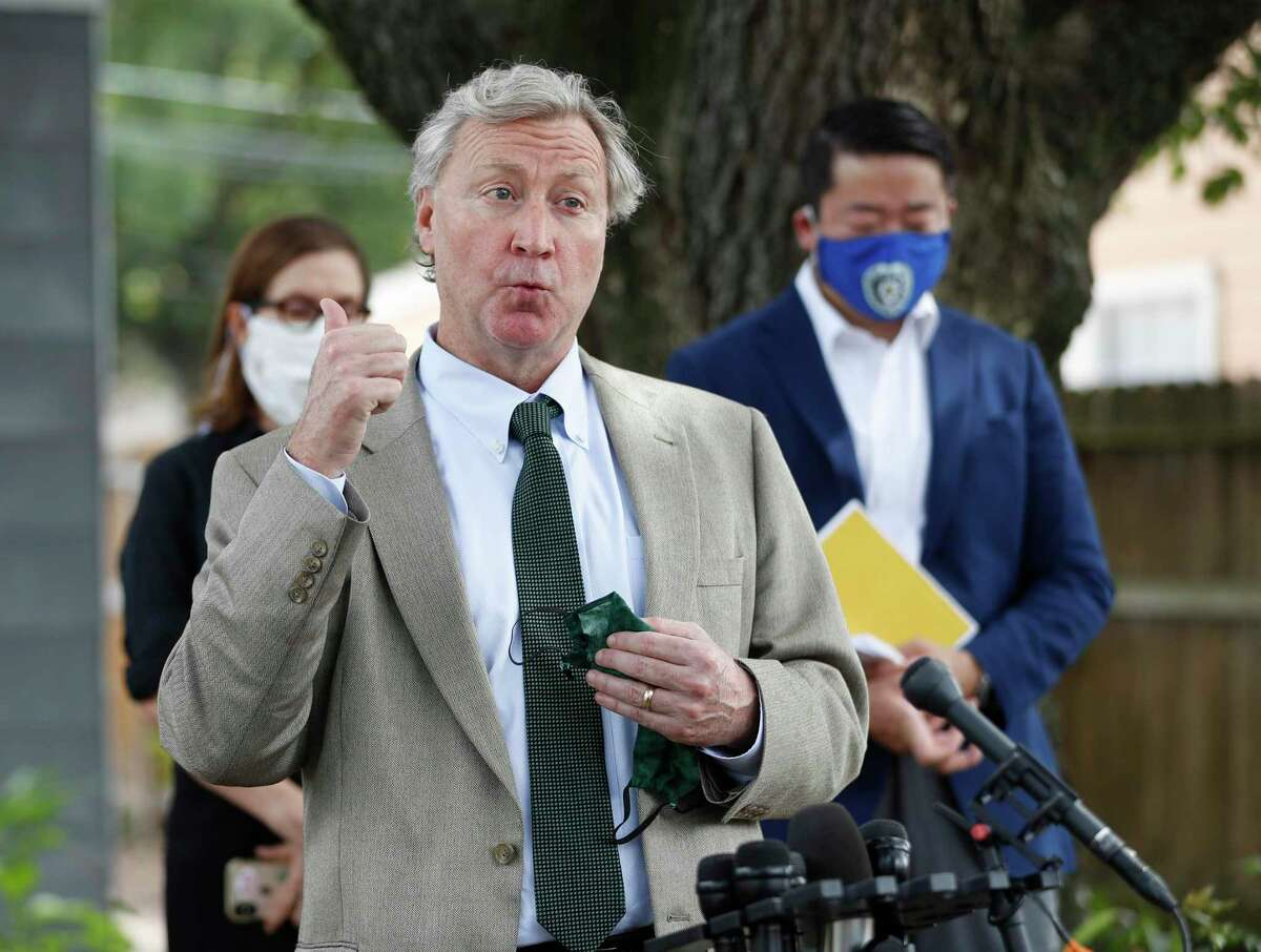 Attorney Mike Doyle representing Rhogena Nicholas speaks to the media with State Rep. Gene Wu and other lawmakers to address the HPD Narcotics Division audit, Thursday, July 2, 2020, in Houston, in front of the home where Rhogena Nicholas and Dennis Tuttle, were killed on Harding Street.