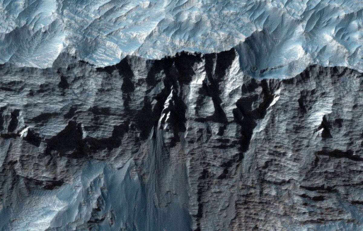The largest canyon in the solar system has been revealed running through the Mars.