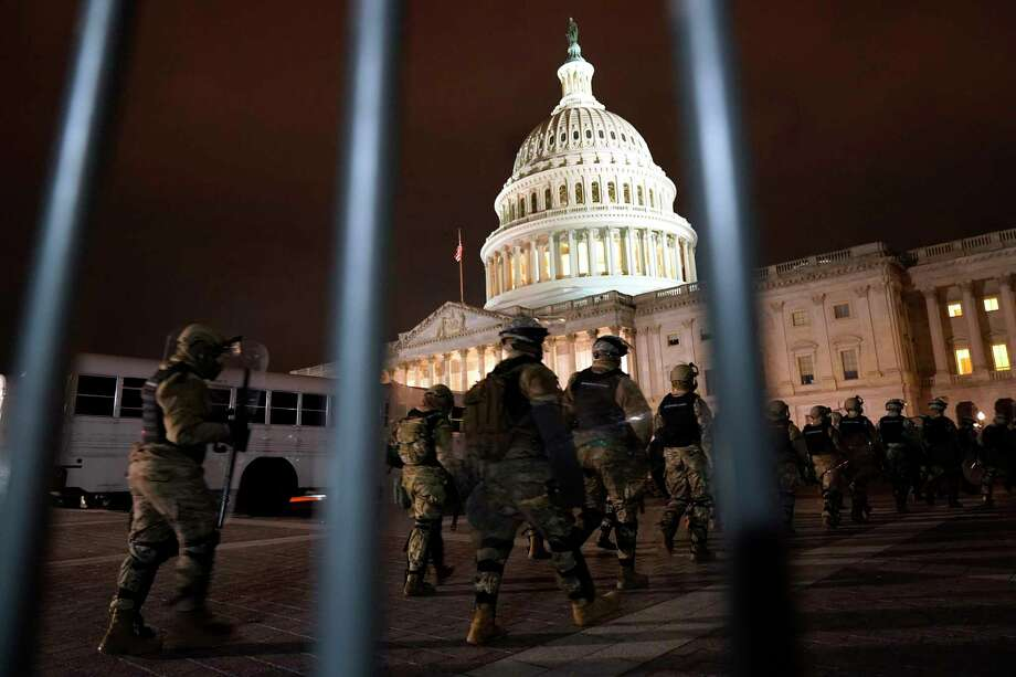 Members of the National Guard arrive to secure the area outside the U.S. Capitol, Wednesday, Jan. 6, 2021, in Washington. (AP Photo/Jacquelyn Martin) / Copyright 2020 Jacquelyn Martin. All rights reserved.