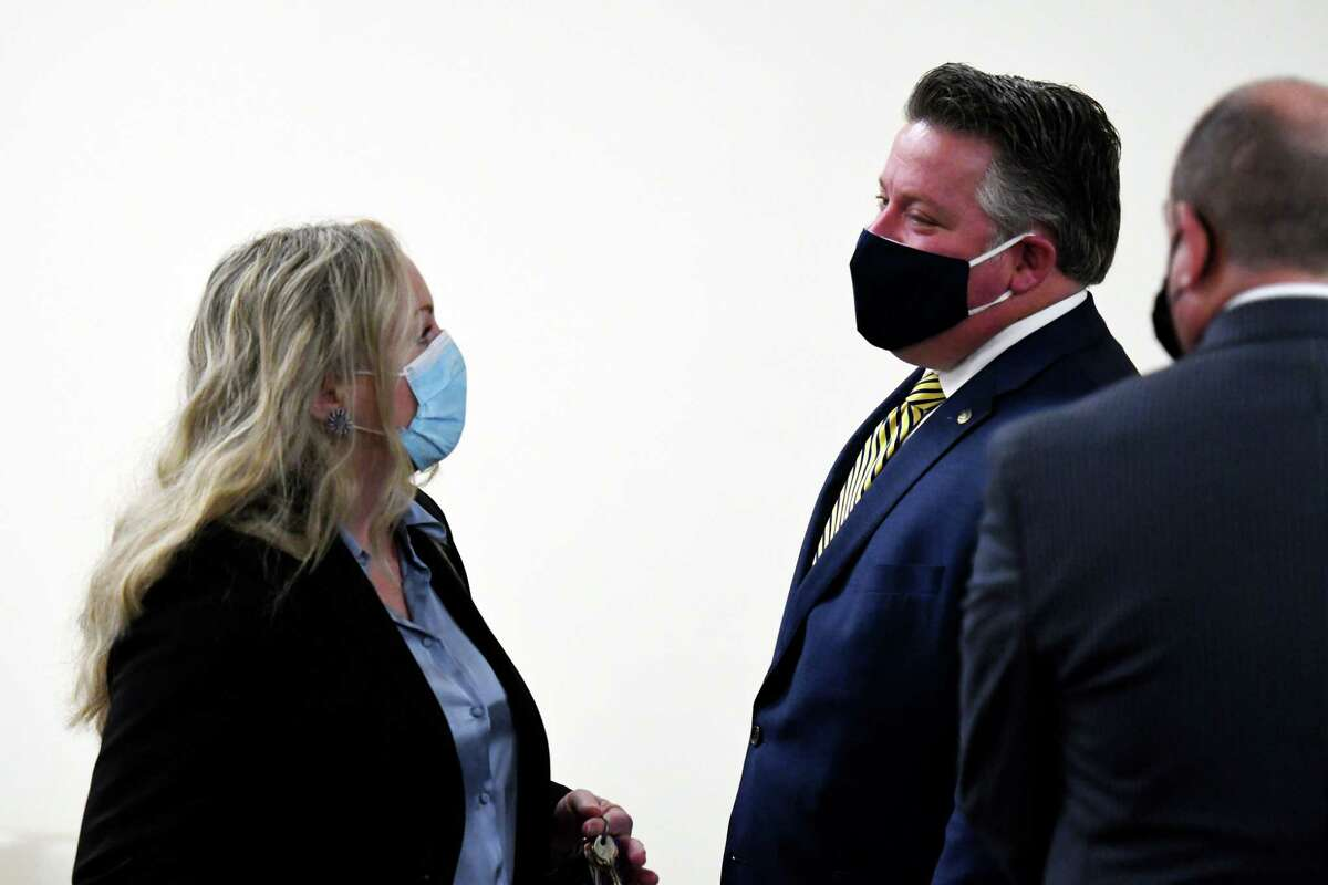 Albany County Health Commissioner Dr. Elizabeth Whalen, left, and Albany County Executive Dan McCoy, right, confer after holding a county coronavirus news briefing on Friday, Jan. 8, 2021, in Albany, N.Y. The county reported one more death and 283 new coronavirus cases overnight. There were also 20 more residents hospitalized, for a total of 163, a new record. Of those, 19 are in intensive care. (Will Waldron/Times Union)