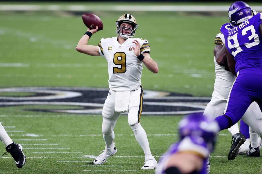 New Orleans Saints quarterback Drew Brees (9) passes in the first half of an NFL football game against the Minnesota Vikings in New Orleans, Friday, Dec. 25, 2020. (AP Photo/Butch Dill) / Copyright 2020 The Associated Press. All rights reserved.