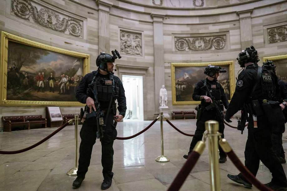Members of the U.S. Secret Service Counter Assault Team walk through the Rotunda as they and other federal police forces responded as violent protesters loyal to President Donald Trump stormed the U.S. Capitol today, at the Capitol in Washington, Wednesday, Jan. 6, 2021. (AP Photo/J. Scott Applewhite) / Copyright 2021 The Associated Press. All rights reserved.