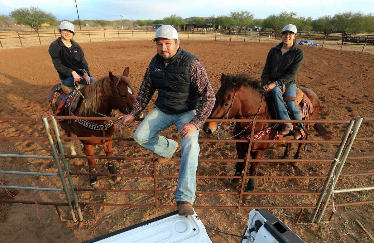 Jimmy Ayala (center), poses with his daughters Emely (from left) and Jackie. He is building his own escaramuza arena on his Floresville ranch.